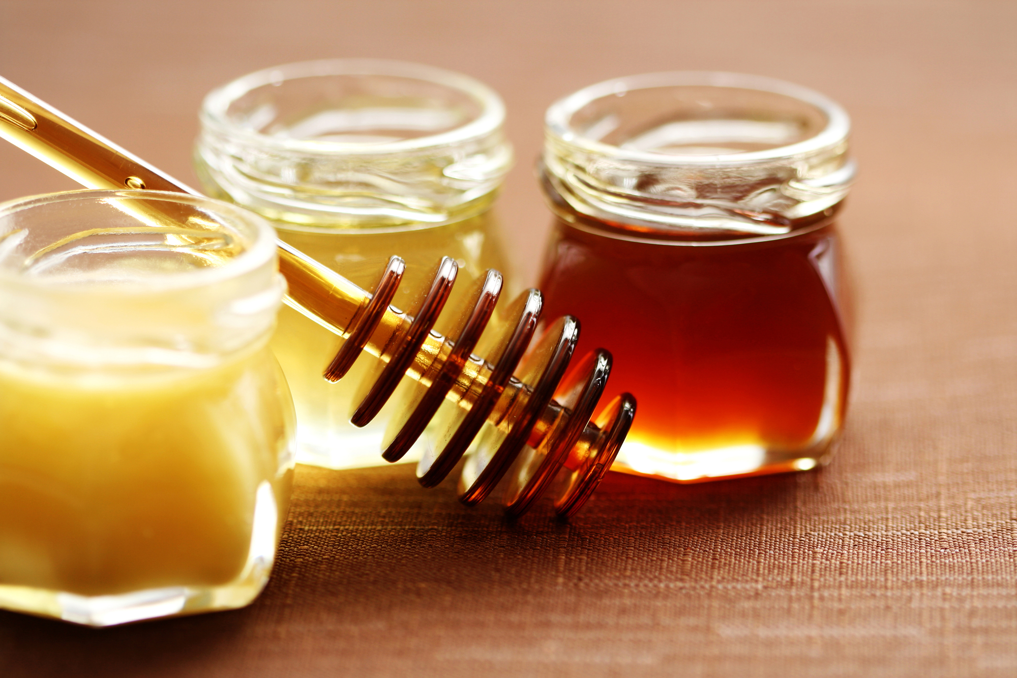 three jars of sweet honey - food and beverages