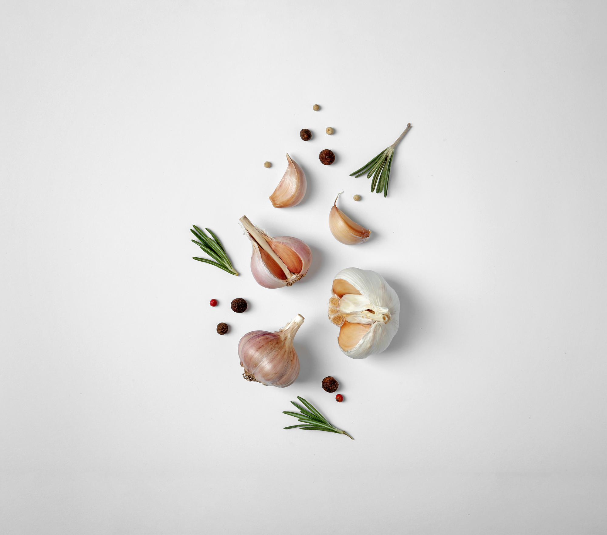 Composition with garlic, pepper and rosemary on white background