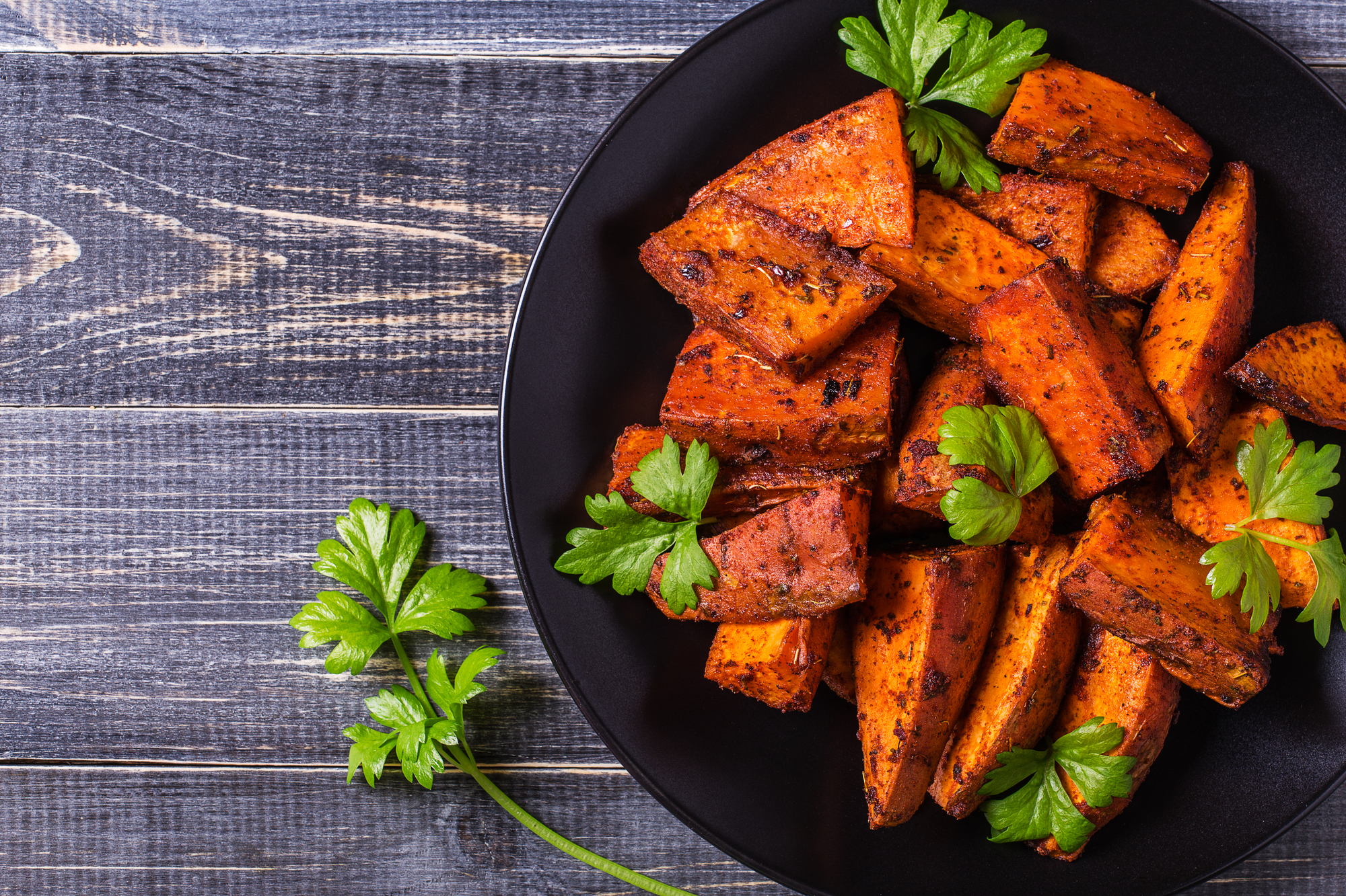 Homemade Cooked Sweet Potato with spices and herbs