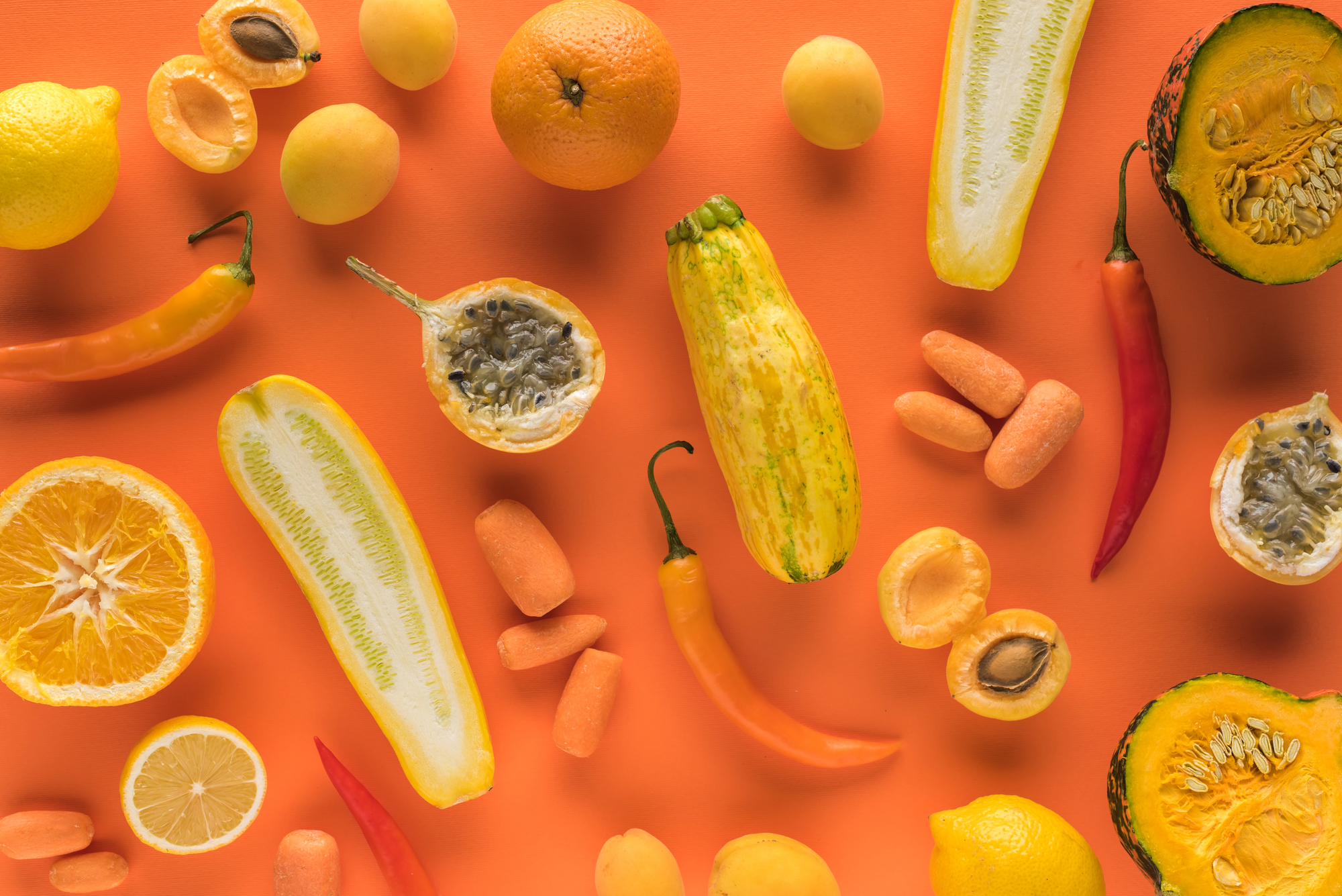Top view of yellow fruits and vegetables