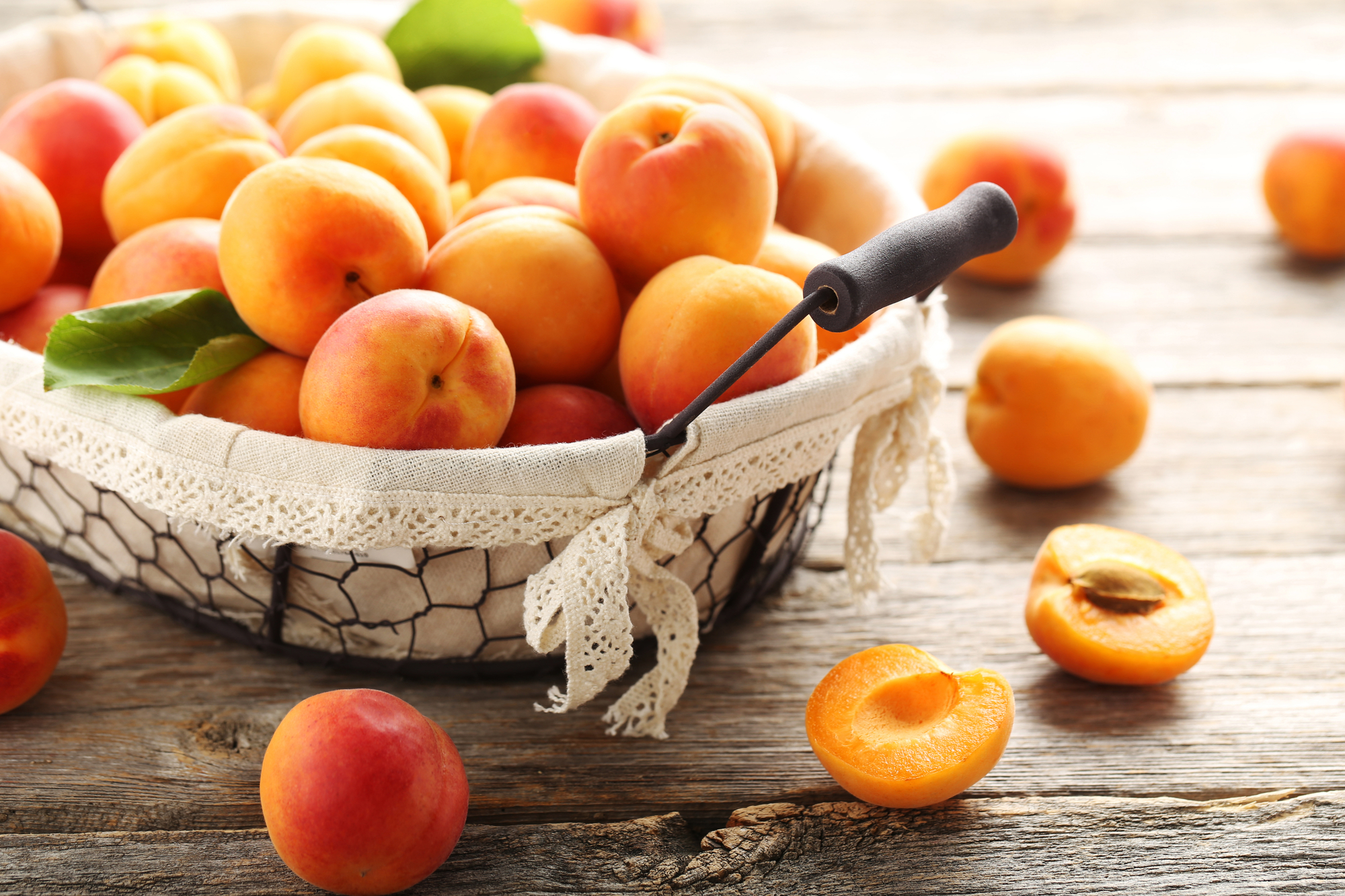 Ripe apricots fruit on grey wooden table